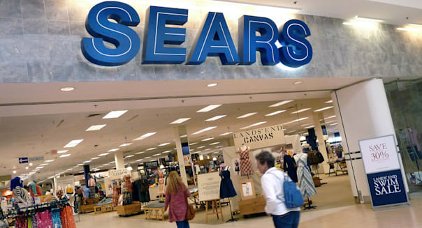 Shoppers walk into Sears in Peabody, Mass., Monday, May 14, 2012.  Sears Holdings Corp. said Thursday, May 17, 2012,  that it?s spinning off a stake in its Canada business, as the struggling retailer looks to focus on stemming declining sales at its remaining U.S. stores.  The announcement came as the company reported that returned to a profit in the first quarter, as a result of a gain on the sale of its stores.  (AP Photo/Elise Amendola)