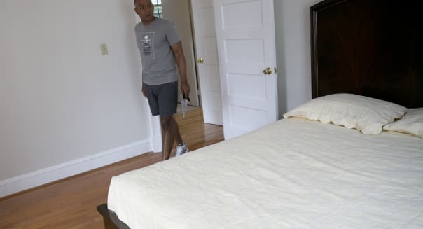 Potential homebuyer Chris Leigh looks in the bedroom of a home for sale during an open house in the 16th Street Heights neighborhood of Washington, D.C., U.S., on Sunday, June 9, 2013. The Mortgage Bankers Association  (MBA) is scheduled to release the U.S. mortgage market index weekly percentage change on June 12. Photographer: Andrew Harrer/Bloomberg via Getty Images