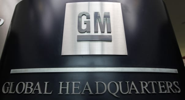 Signage for General Motors Co. (GM) is displayed at the Renaissance Center, the global headquarters of GM in Detroit, Michigan, U.S., on Thursday, June 6, 2013. General Motors Co., aiming to increase customer loyalty, announced it will expand its free scheduled maintenance program to most 2014 Chevrolet, Buick and GMC vehicles in the U.S. Photographer: Jeff Kowalsky/Bloomberg via Getty Images