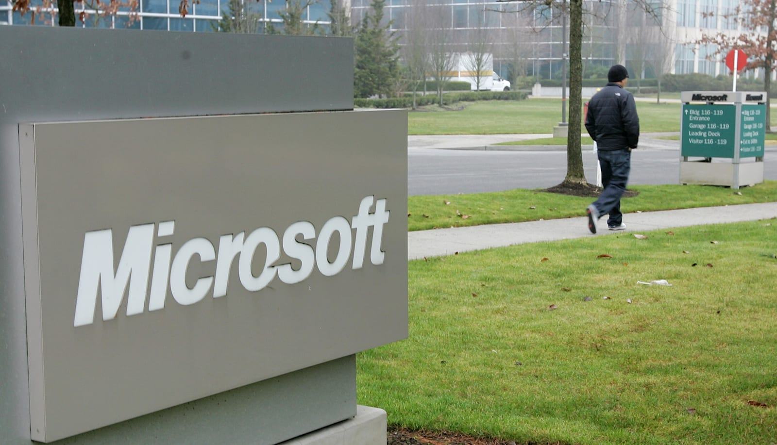 person-walks-past-a-microsoft-sign-on-ja