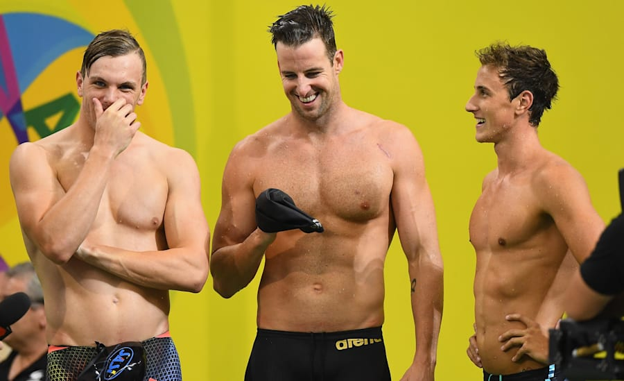 Swimming - Campbells power Australia to record and relay gold