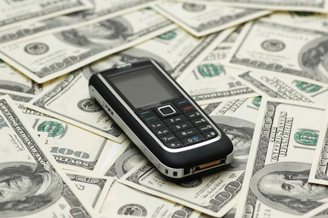 mobile phone and dollar bank...