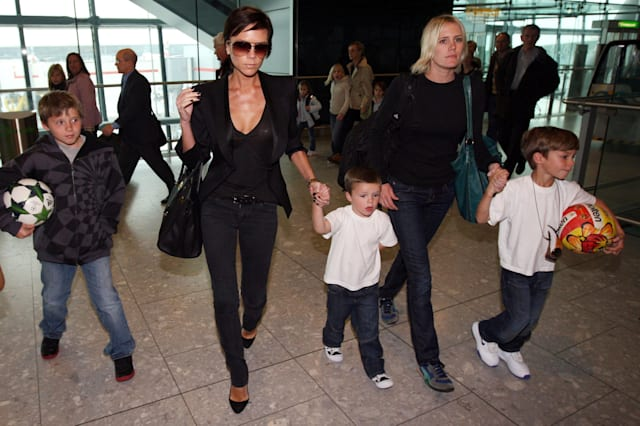 Victoria Beckham and sons at Heathrow