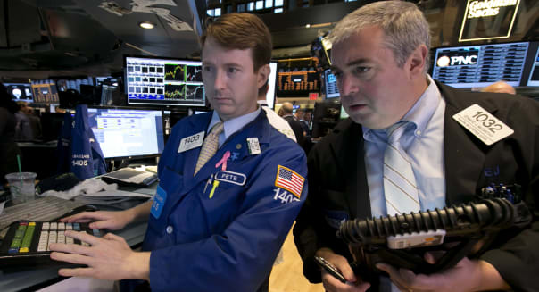 Wall Street (Specialist Peter Elkins, left, and trader Edward McCarthy work on the floor of the New York Stock Exchange Wednesda