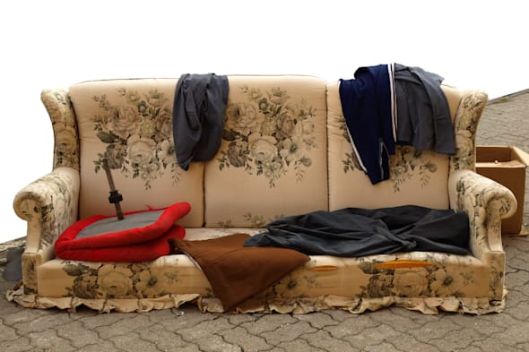 old sofa with clothes used by...