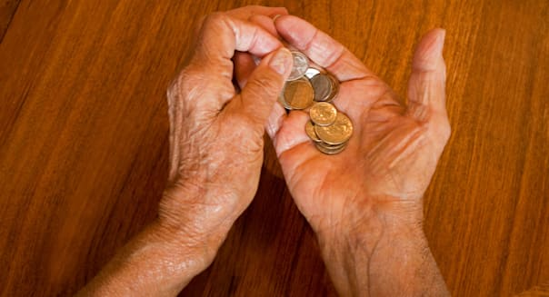 BMR1HW senior hands holding coins scam adult senior poor cost finances old hands holding counting coins loss negative nobody