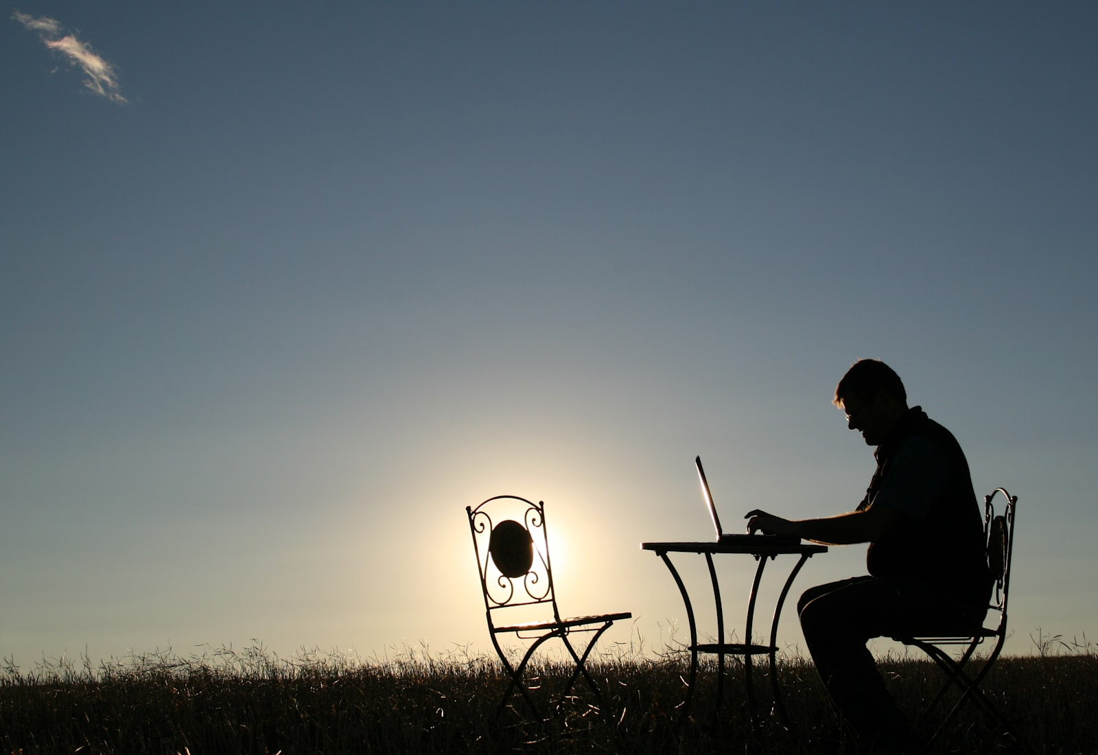 silhouette-of-a-man-working-late-outside