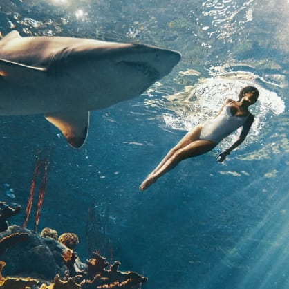 Rihanna swims with sharks for her Harper's BAZAAR cover... but actually.