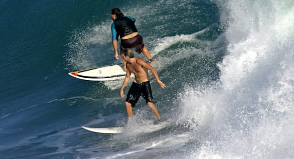 Surfers sharing a wave. Lagundri Bay, Nias, Sumatra, Indonesia, Southeast Asia, Asia