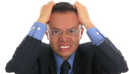 businessman looking upset ...