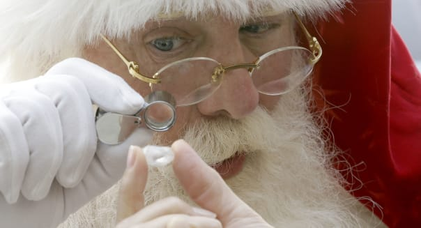 Neiman Marcus Christmas Book (Actor Brady White portrays Santa Claus as he looks at a 25-carat rough Forevermark diamond  offere