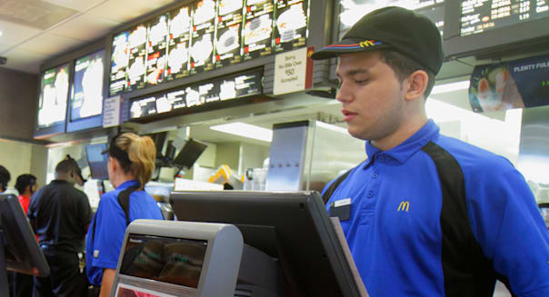 Florida Miami Homestead McDonald's fast food restaurant inside counter employee Hispanic man cashier customer