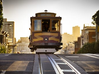 Cable Car on California Street line reaches the crest of Nob Hill in San Francisco, California.