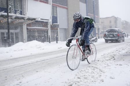 bicycle courier in winter snow...