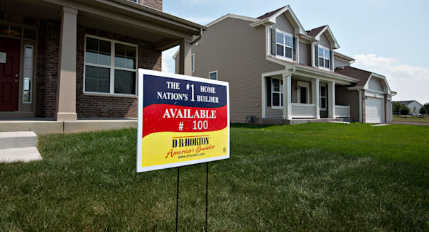 A sign stands outside a new home for sale in the D.R. Horton Inc. Cambridge at Southbury development in Oswego, Illinois, U.S., on Tuesday, Aug. 20, 2013. The Commerce Department is scheduled to release new home sales figures on Aug. 23. Photographer: Daniel Acker/Bloomberg via Getty Images