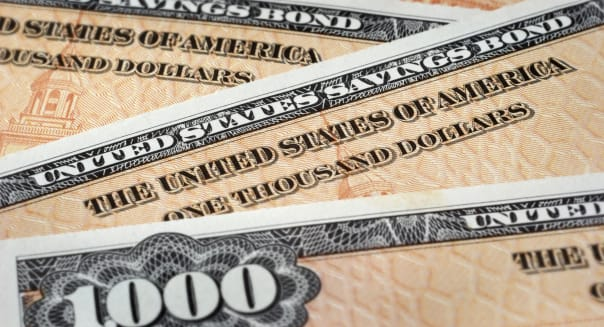 'Close up photograph of U.S. Savings Bonds, selective focus.Similar image:'