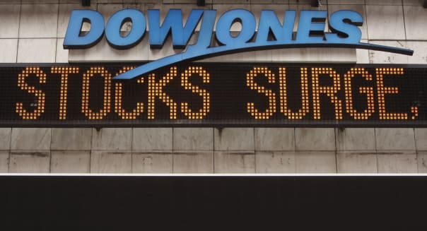 The Dow Jones ticker in Times Square displays news about the