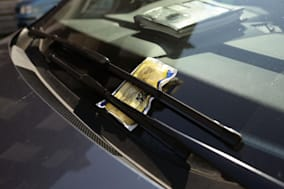 File photo dated 01/08/13 of a parking ticket on a car windscreen. Parking fines could be reduced and grace periods introduced, the Government has said, following criticism that local councils use parking enforcement as a