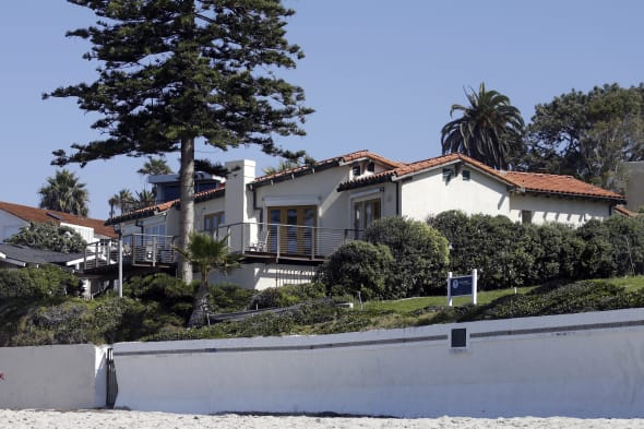 Romney Home (People walk along the beach in front of a home owned by former presidential candidate Mitt Romney, and his wife Ann