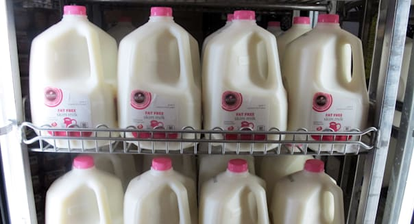 Farm Bill Q&A (FILE - This Dec. 4, 2012, file photo shows gallons of milk arranged at a Milwaukee grocery store. This week the S