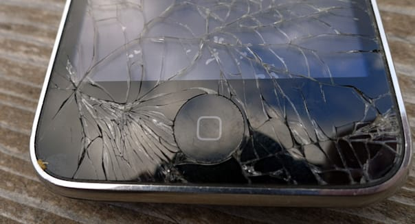 An iPhone with cracked screen