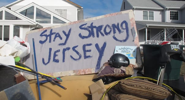 Noreaster (Residents of a flood-wrecked home in Point Pleasant Beach N.J. offer encouragement to fellow victims of Superstorm Sa