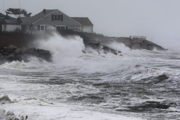 Superstorm Sandy (Waves batter the coast near homes in Narragansett, R.I., Monday, Oct. 29, 2012. A fast-strengthening Hurricane