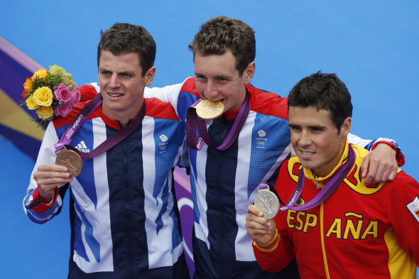 London Olympics Triathlon Men (Great Britain's Alistair Brownlee, middle, displays the gold medal, Spain's Javier Gomez, right,