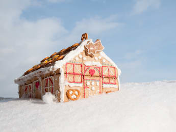 christmas cookies house in snow ...