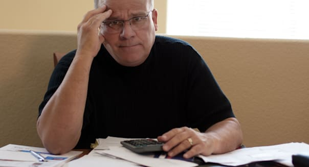 mature male worried and frustrated about bills