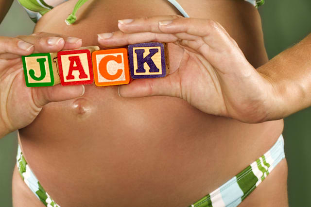 Pregnant woman with toy blocks