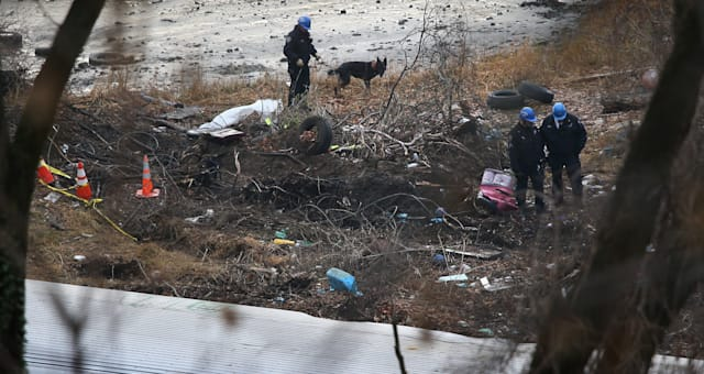 Investigators Examine Site Of Commuter Train Crash In NYC That Killed Four