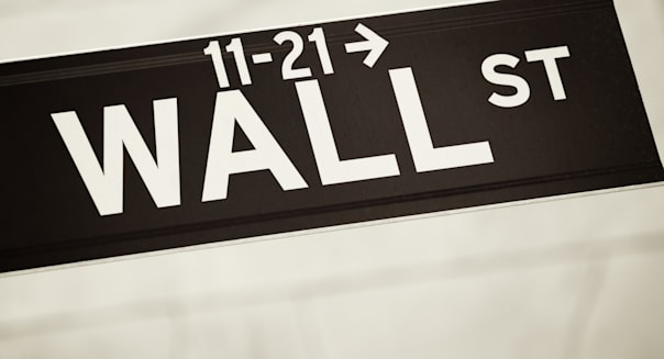 Wall Street Sign Close Up Against Stone Background