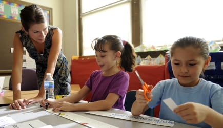 DENVER,CO--Master teacher, Lindsey Erisman, left, works with students, karen Hernandez, 6-years-old, center, and America Garcia,