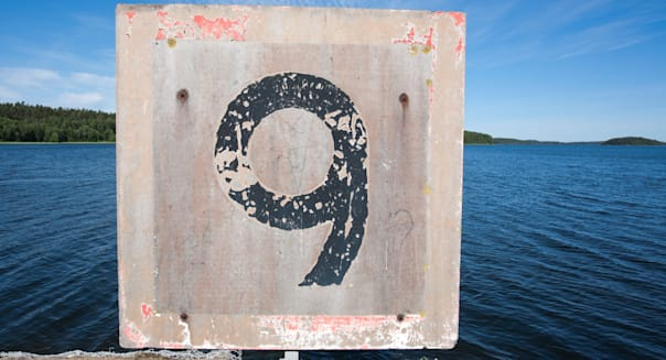 weathered old speed limit sign at harbour