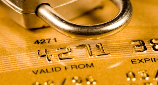 B5BKY6 Close up of a credit or debit card for security background. Image shot 2008. credit; card; identity; theft; online; secur