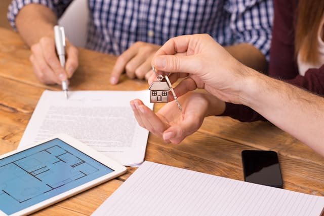 Close up hands receiving house keys