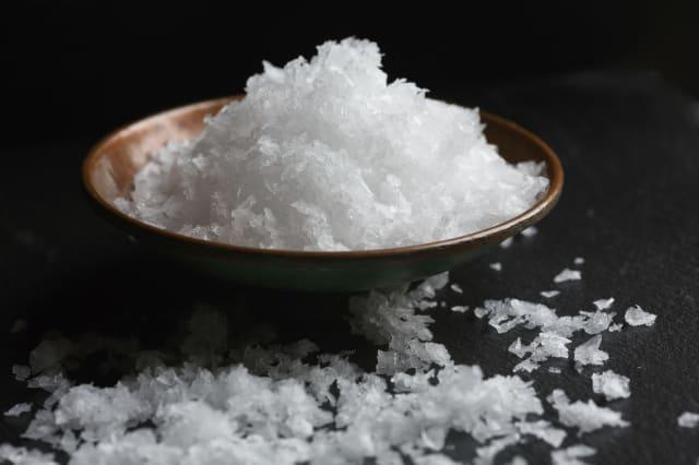 Maldon sea salt on black background
