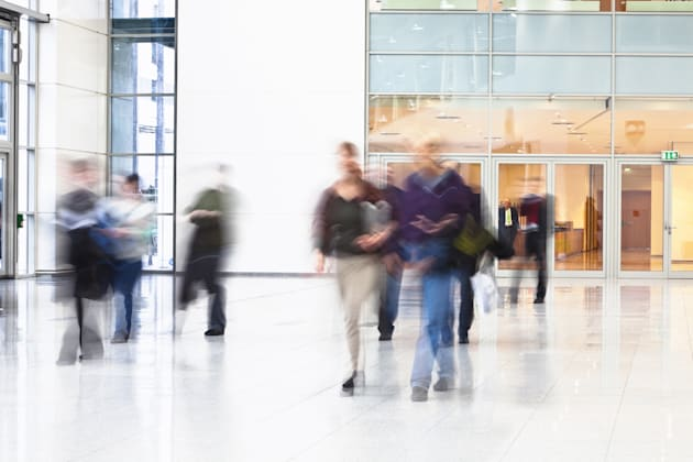 Blurred People Walking in Modern Interior
