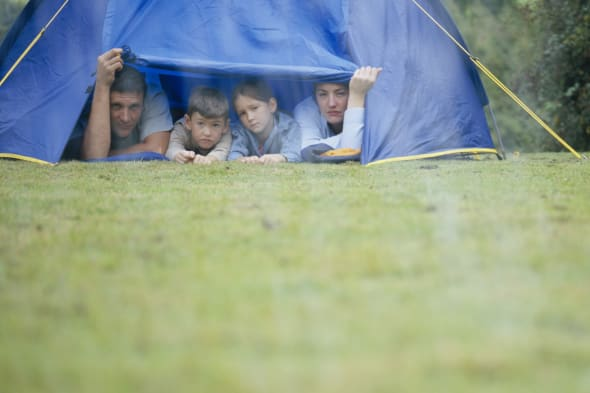 Family in Tent Looking at Rain