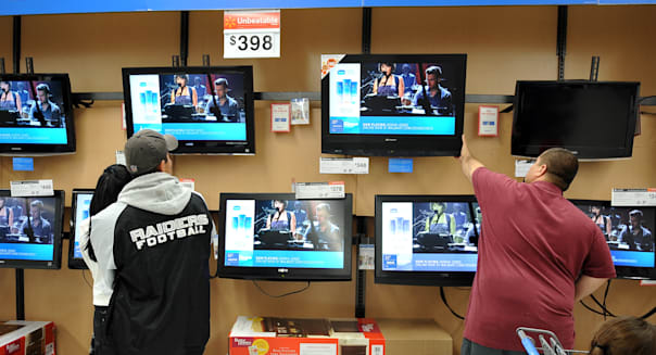 Shoppers look at flat-screen televisions