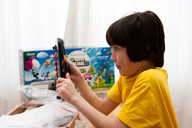 Caucasian child, tween, 10 to 12 years old, playing with Nintendo Wii U game console