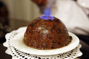 Christmas pudding alight with flames on top.