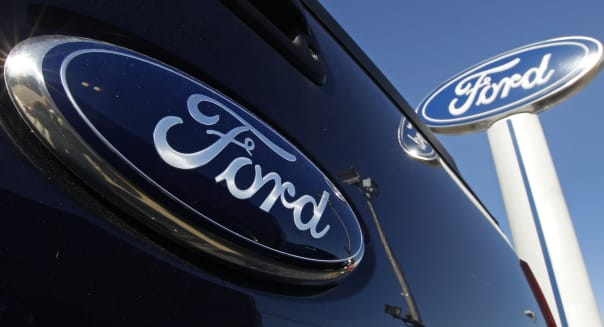 Earns Ford (FILE - This Oct. 25, 2011, file photo, shows a Ford logo,on the tailgate of a pick-up truck, and on a Ford dealershi