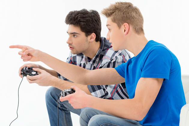 gamers with joystick. side view ...