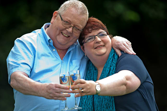 Colin Weir (L) and his wife Chris pose f