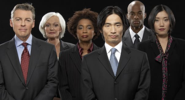 Group of businesswomen and businessmen standing together, portrait