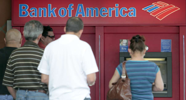 Earns Bank Of America (This photo taken Friday, Oct. 14, 2011, shows customers in line a  Bank of America ATM in Hialeah, Fla. B
