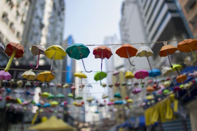 Colorful paper umbrellas are folded and hung on the road in Hong Kong during Umbrella movement.