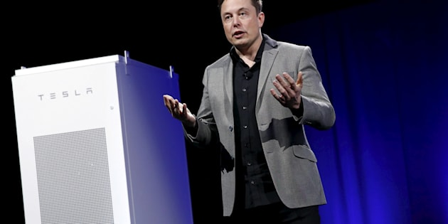 Patrick Fallon  Reuters                       Elon Musk with one of his Tesla batteries